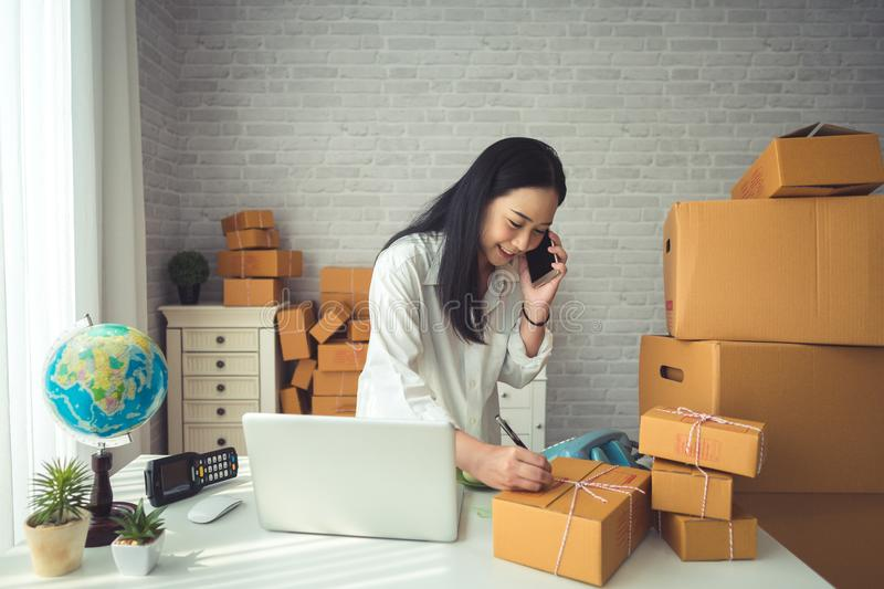Young Asian Woman Working at home. royalty free stock photography