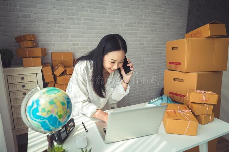 Young Asian Woman Working at home. royalty free stock image