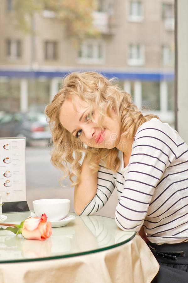 Download Young woman at small cafe stock photo. Image of date - 28264418