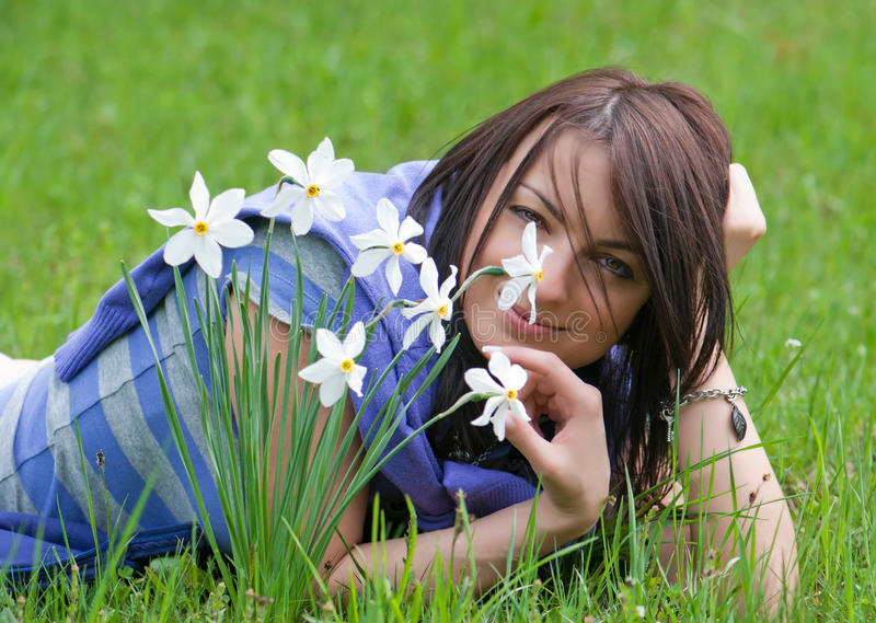 Young woman smelling daffodils stock photos