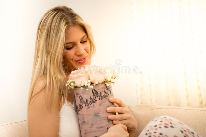 Young woman smells of rose. royalty free stock photo