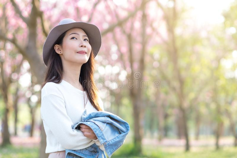 Young woman enjoying cherry blossom garden in Spring day royalty free stock photos