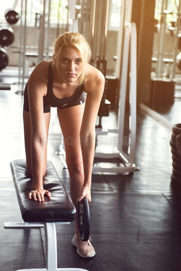 A young woman smile and training with dumbbell stock photo