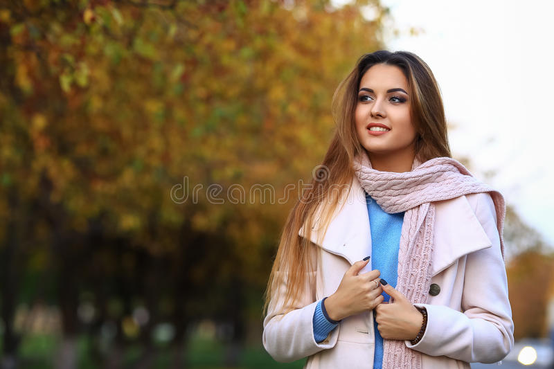Young woman smiling and fall yellow maple garden background. free space. stock photo