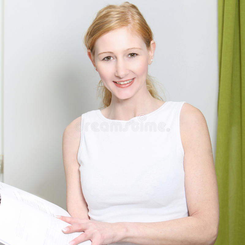 Young woman smiling with folders