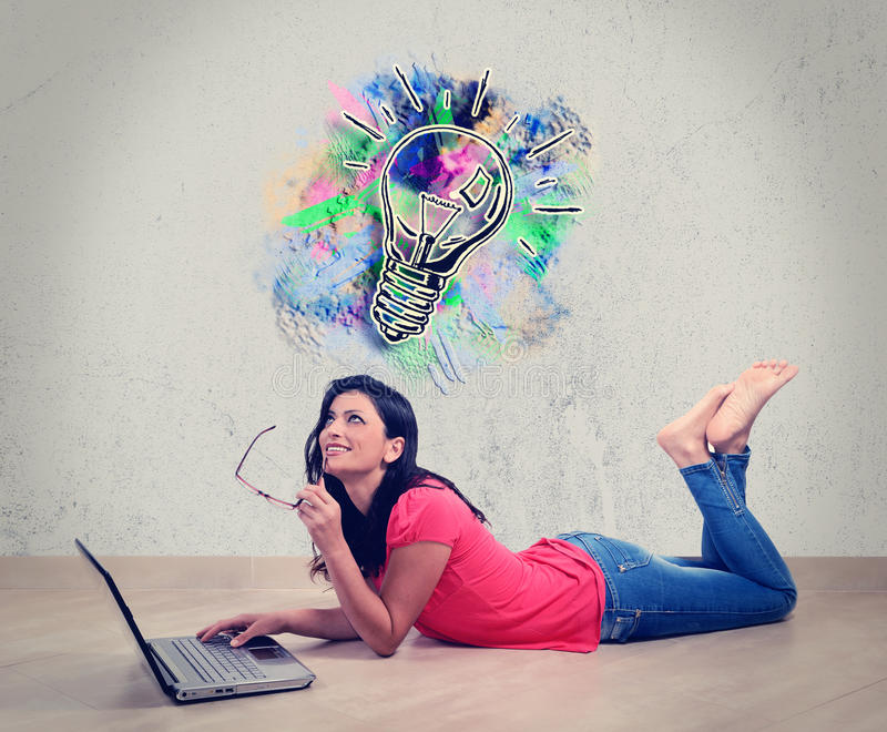 Young woman smiling in front of laptop royalty free stock image