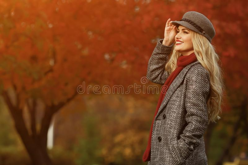 Young woman smiling on the red garden background. stock image