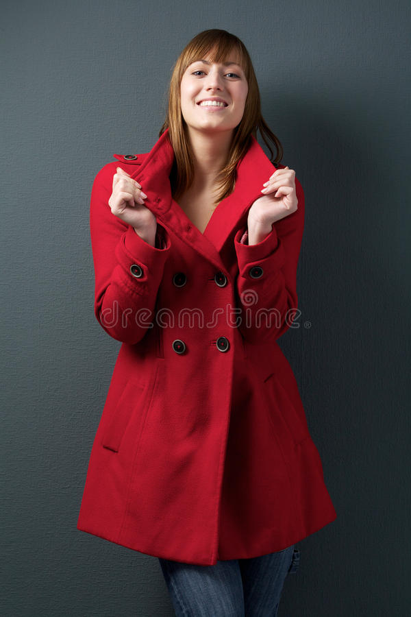 Young Woman Smiling In Red Winter Jacket Royalty Free Stock Image