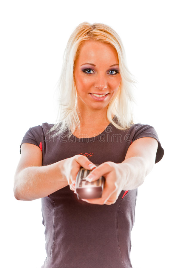 Young woman smiling with TV remote control royalty free stock image