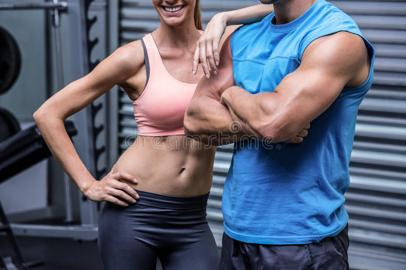Young woman smiling with a young man stock image