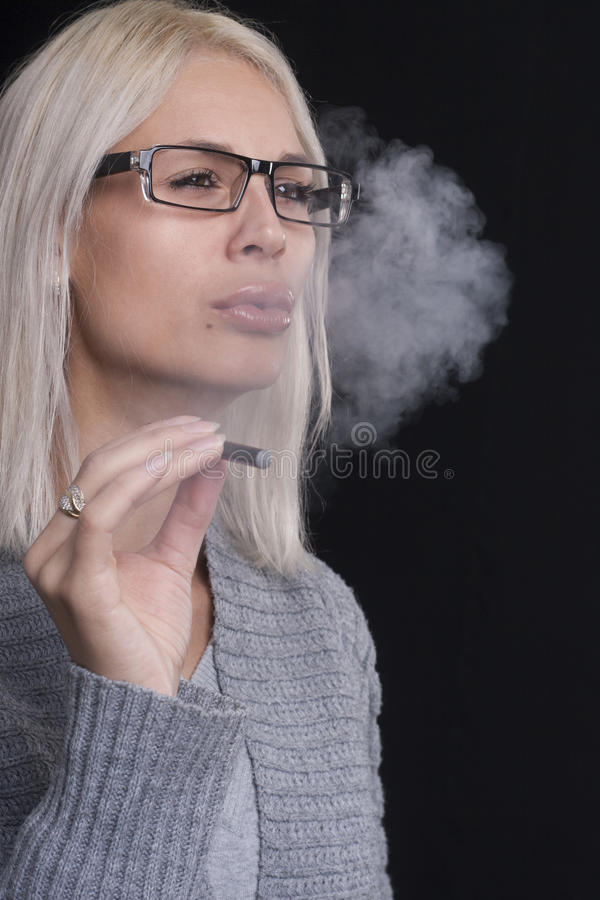 Free Young Woman Smokin Electic Cigarette Royalty Free Stock Image - 35596456