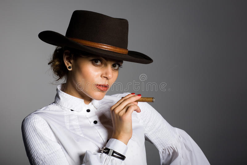 Download Young Woman Smoking A Cigar. Stock Photo - Image: 21041024
