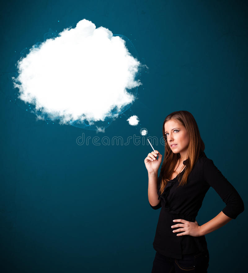 Young woman smoking unhealthy cigarette with dense smoke. Pretty young woman smoking unhealthy cigarette with dense smoke royalty free stock photo