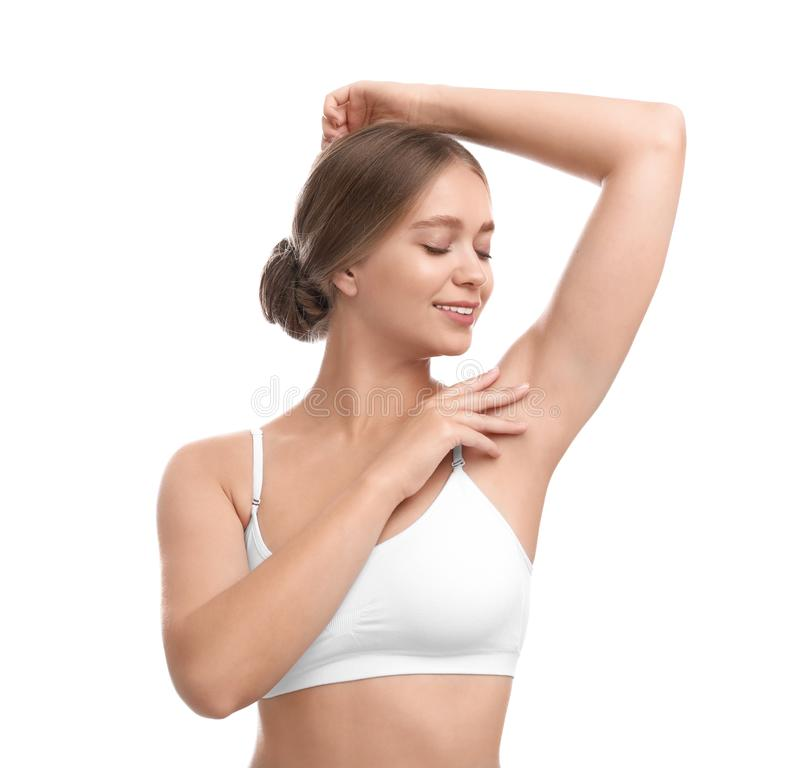 Young woman with smooth clean  on white background. Using deodorant stock photo