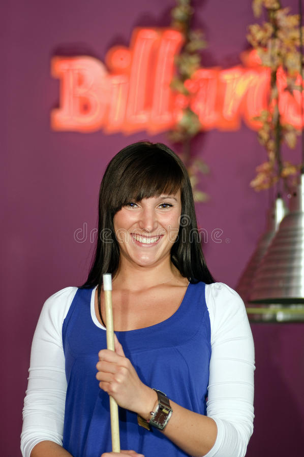 Young woman during snooker game. stock photos
