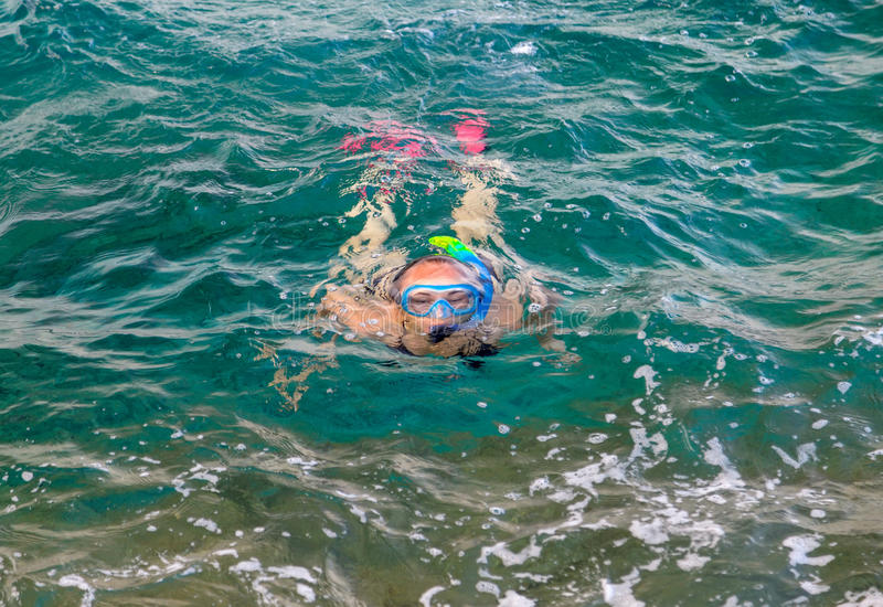 Young woman snorkeling. In the mediterranean sea royalty free stock images