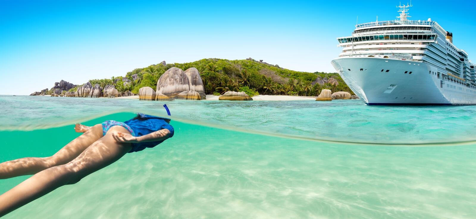 Young woman snorkeling next to tropical island stock images