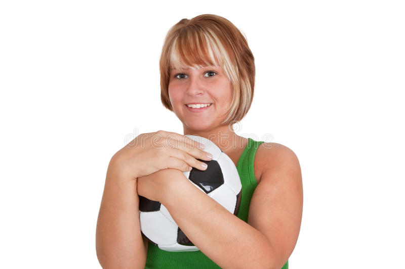 Young woman with soccer ball stock photos