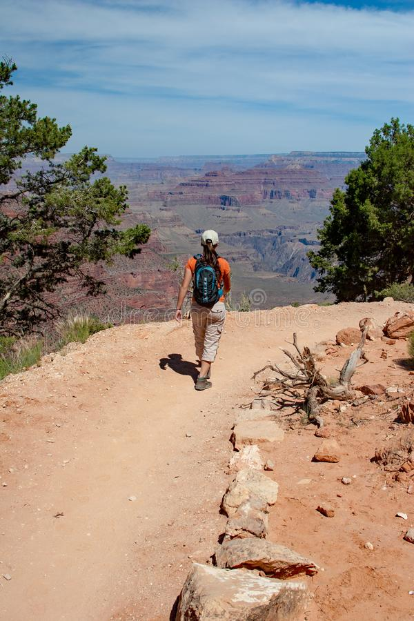 Young woman on South Kaibab Trail in Grand Canyon. Young woman hiking on South Kaibab Trail in Grand Canyon National Park South Rim, Arizona on sunny summer royalty free stock photos