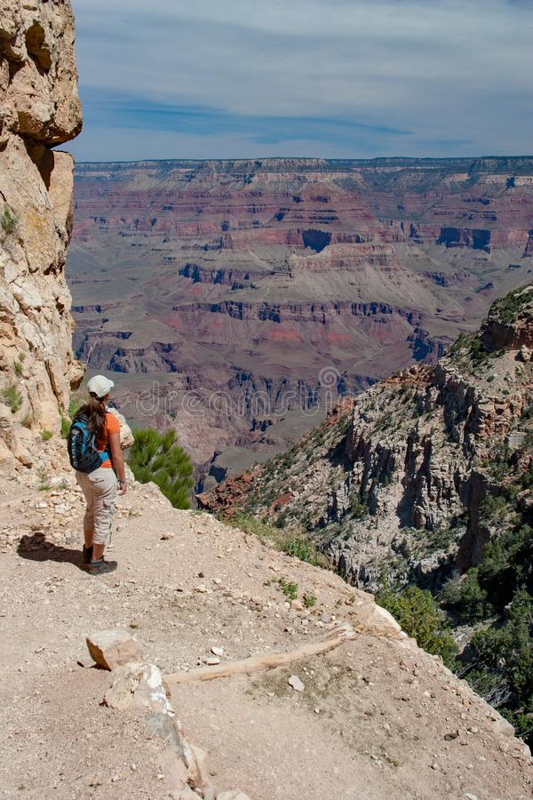 Young woman on South Kaibab Trail in Grand Canyon. Young woman hiking on South Kaibab Trail in Grand Canyon National Park South Rim, Arizona on sunny summer stock photos