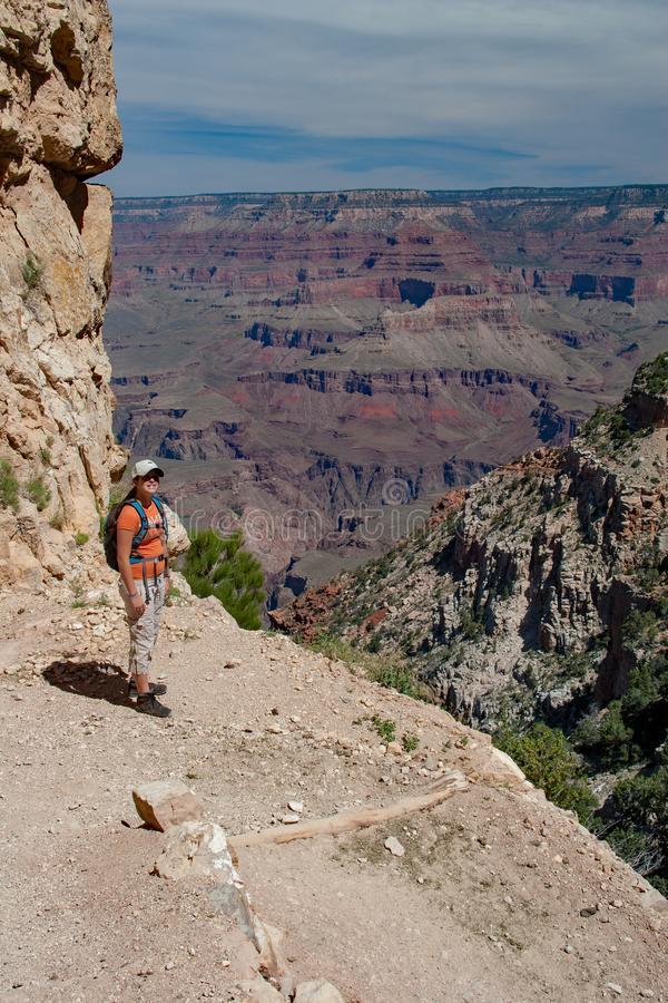 Young woman on South Kaibab Trail in Grand Canyon. Young woman hiking on South Kaibab Trail in Grand Canyon National Park South Rim, Arizona on sunny summer stock image