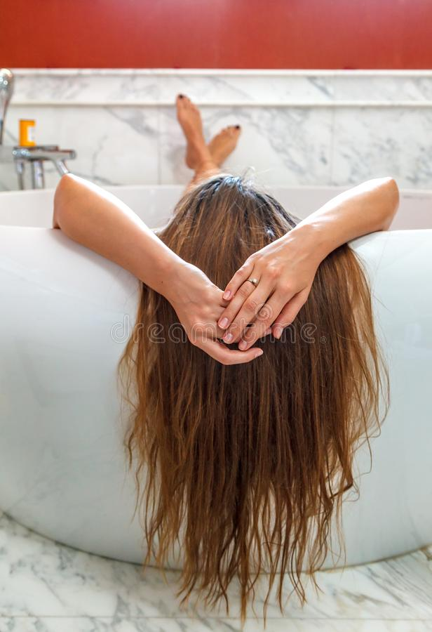 Young woman in spa enjoying bath and relaxing royalty free stock photo
