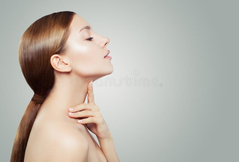 Young woman spa model with clear skin on white background. Facial treatment, aesthetic medicine and cosmetology concept.  stock image