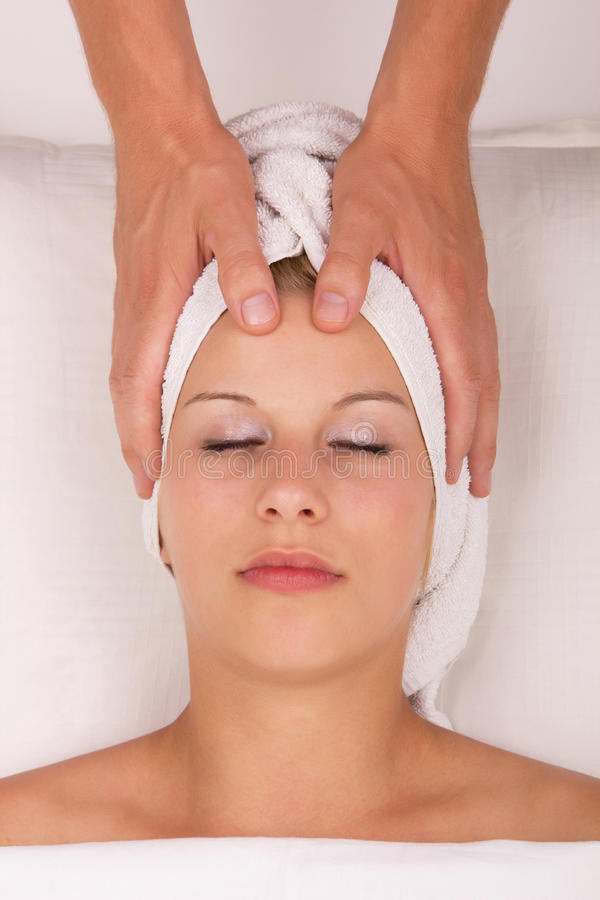 Young woman in spa salon stock image