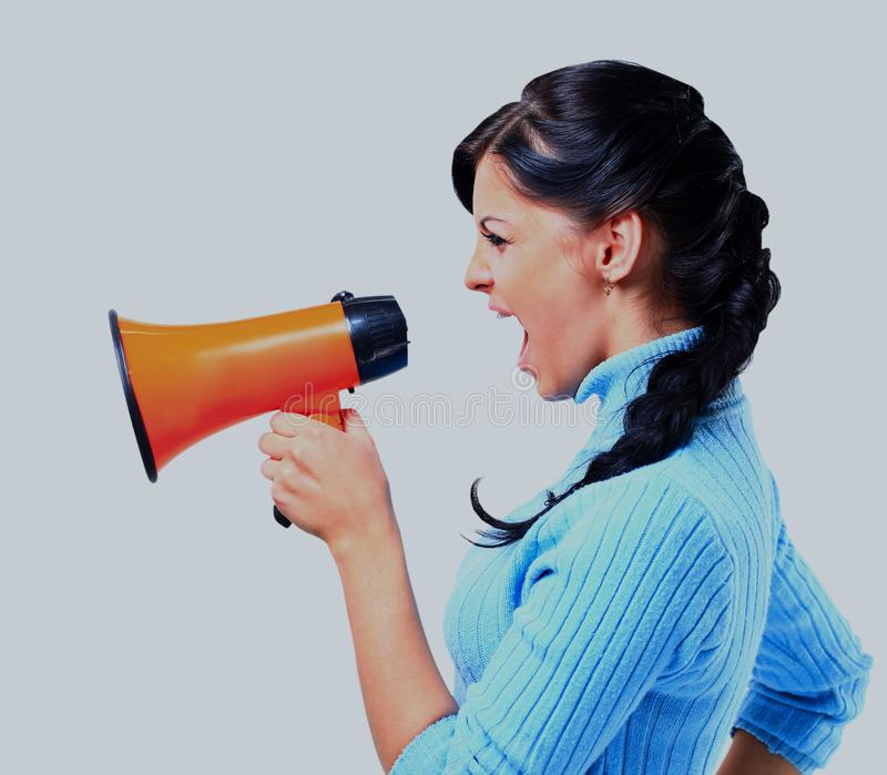 Young woman speaking through megaphone. stock photo