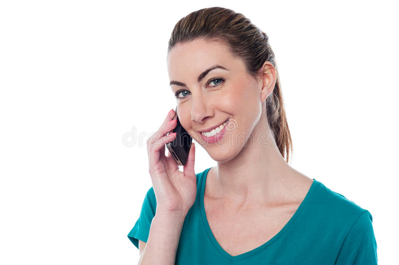 Young Woman Speaking Over Cellphone Royalty Free Stock Images