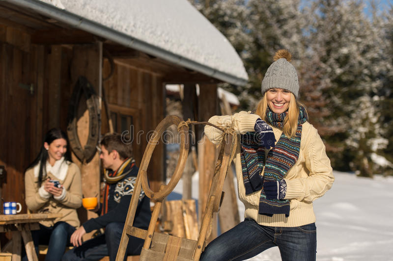Young woman spend holiday winter show cottage royalty free stock images