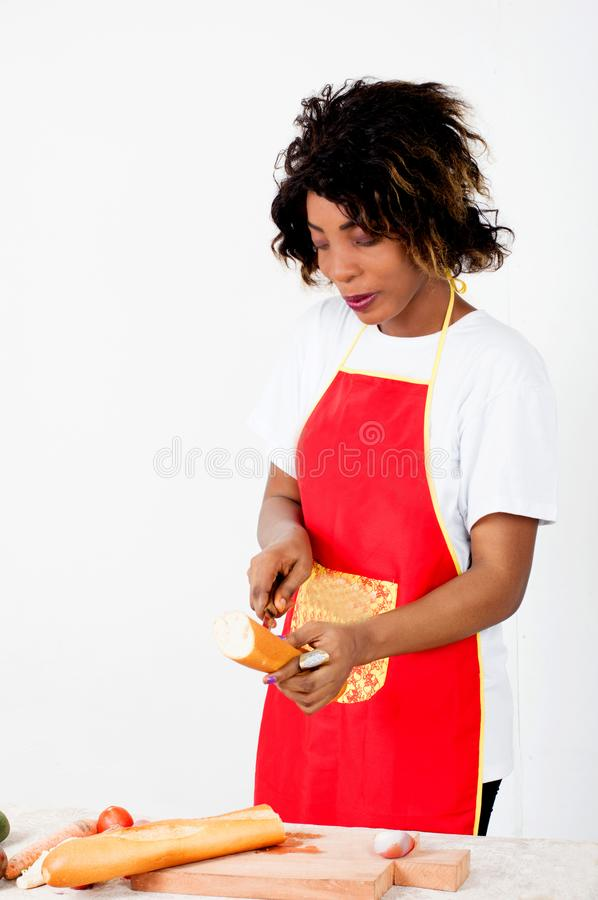 Young woman splitting a piece of bread. stock images