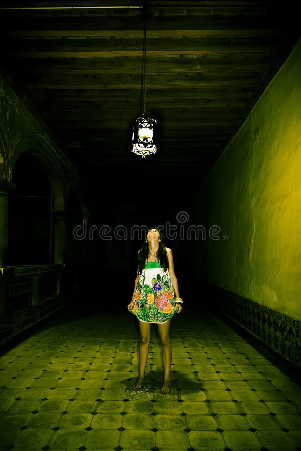 Young woman in spooky corridor stock photography