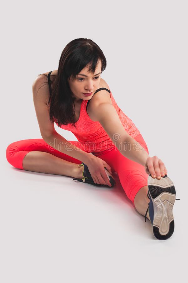 Young woman sport stretching on the white background stock photography