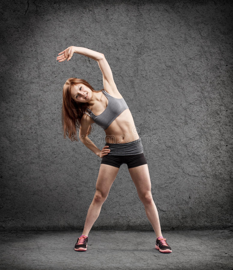 Young woman in sport wear stock photos