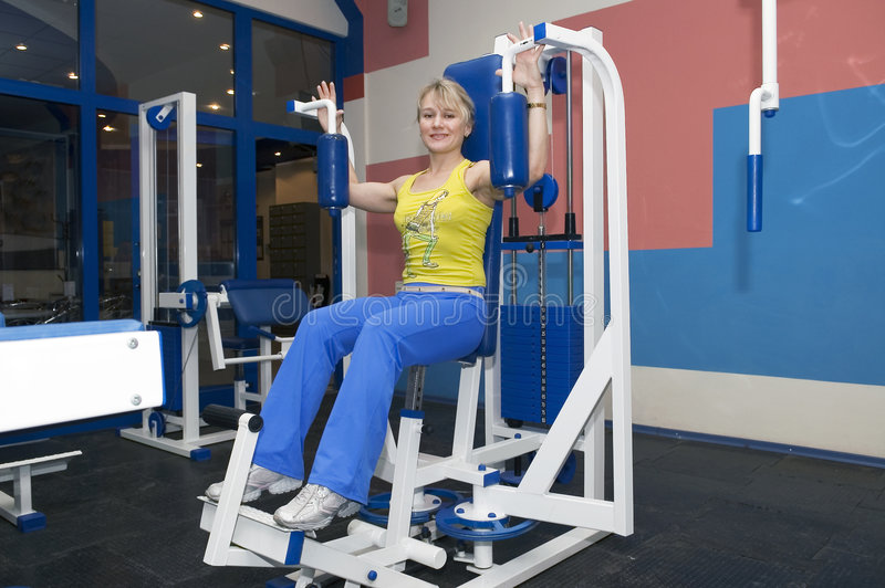 Young woman in sportclub stock image