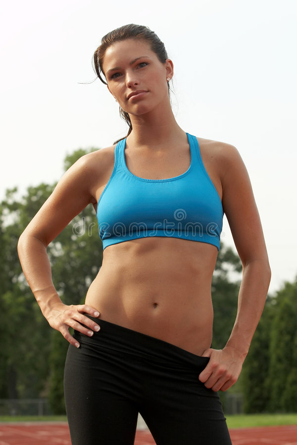 Download Young Woman In Sports Bra With Hands On Hips Stock Image - Image: 1403755