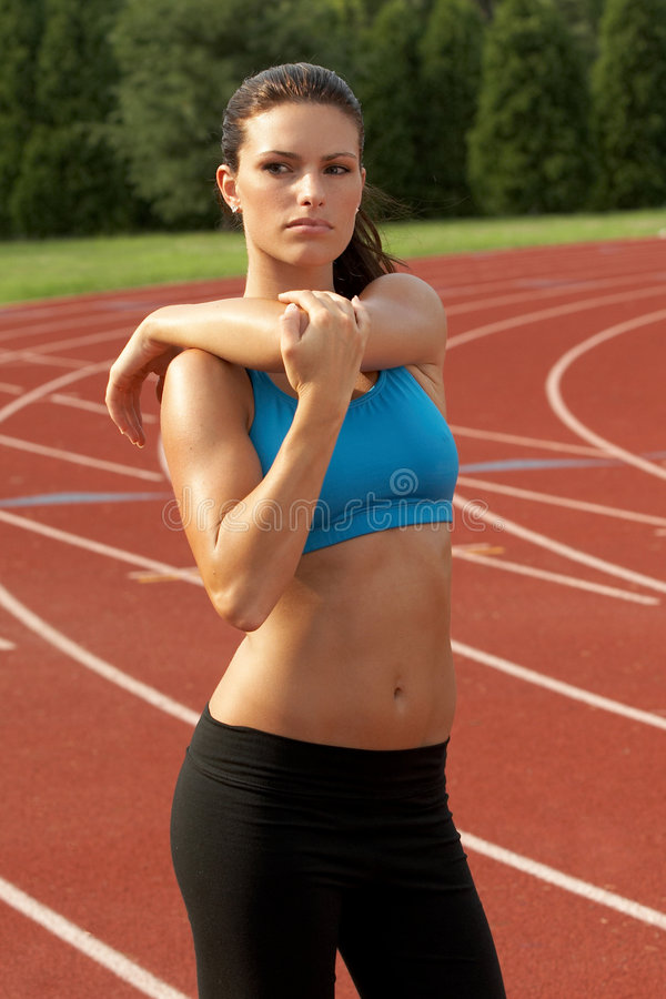 Download Young Woman In Sports Bra Stretching Triceps Muscle Stock Image - Image: 1403707