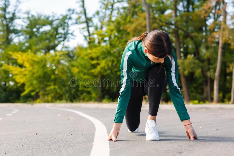 A young, attractive and sporty woman going to be running outdoor. royalty free stock photos