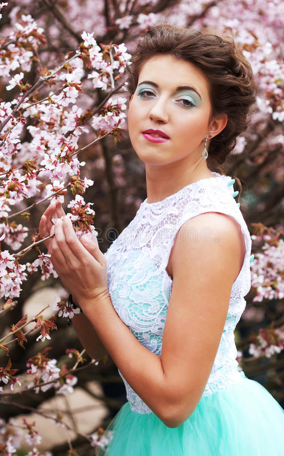 young woman at spring garden, wearing long dress stock photo
