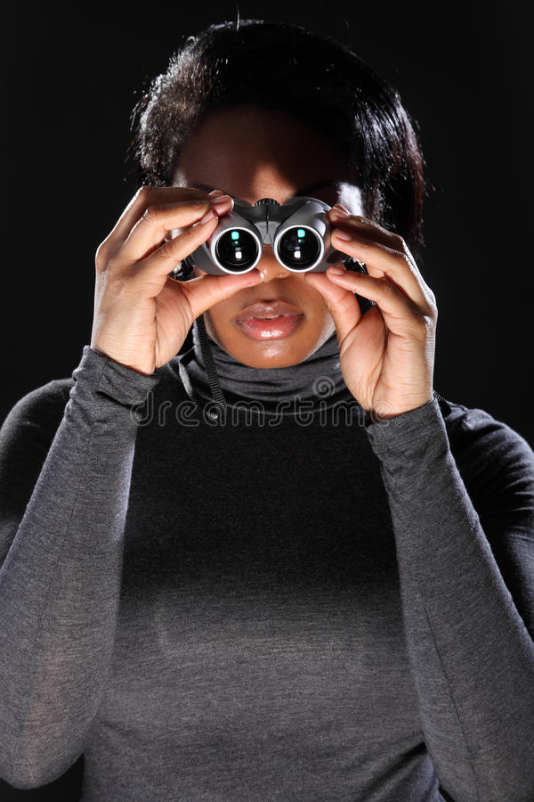Download Young Woman Spy Looking Through Binoculars Stock Photo - Image: 18345922