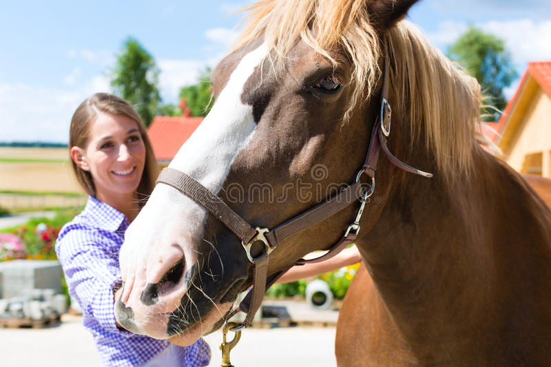 Download Young Woman In The Stable With Horse And Is Happy Stock Image - Image: 28157377