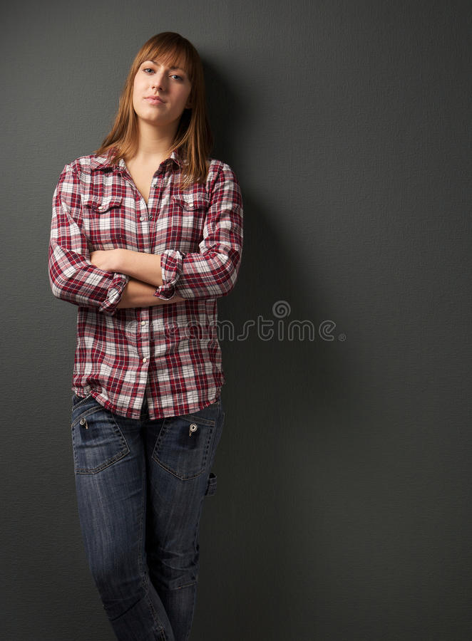 Young Woman Standing Alone With Arms Crossed Royalty Free Stock Photography