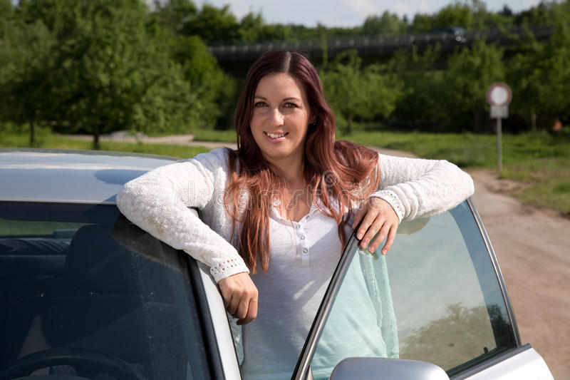 Download Young Woman Standing At A Car Royalty Free Stock Photos - Image: 33525178