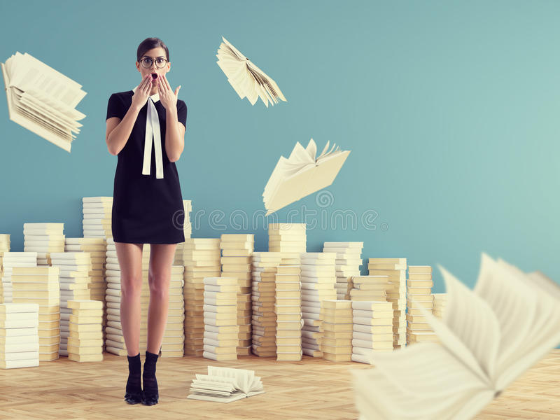 Young woman standing infront of stack books. education concept. stock image