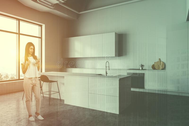Woman in white kitchen corner with bar royalty free stock photography