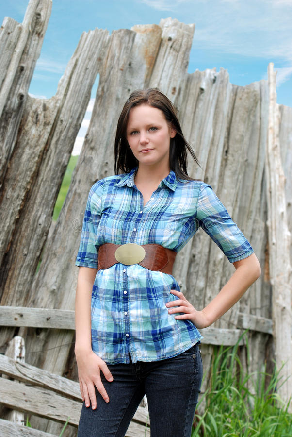 Download Young Woman Standing Near Old Wood Post Fence Royalty Free Stock Images - Image: 14787719