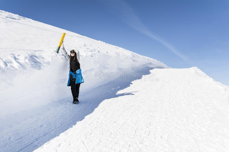 Young Hiker Woman in the Winter Mountain. Young woman standing near winter mountain valley - adventure concept royalty free stock images