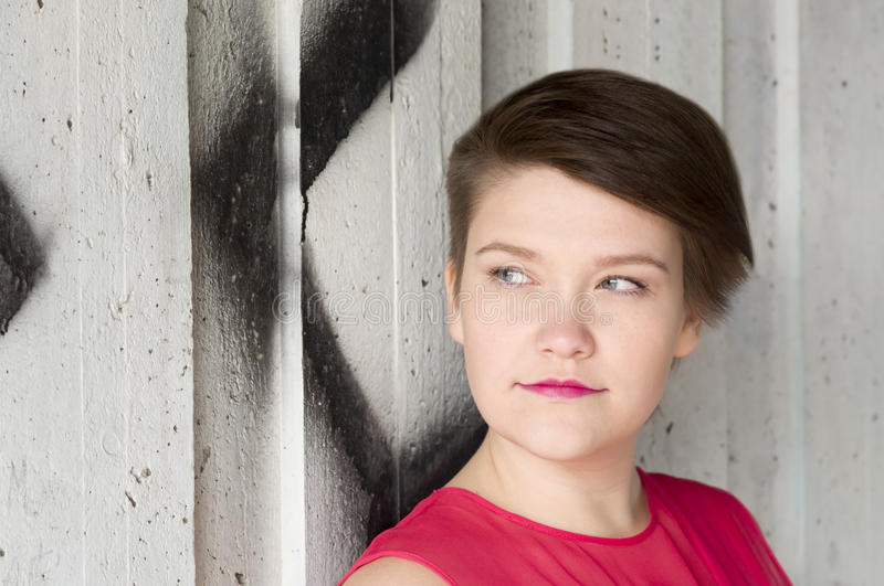 Young Woman Standing Next To Graffiti Wall Stock Images