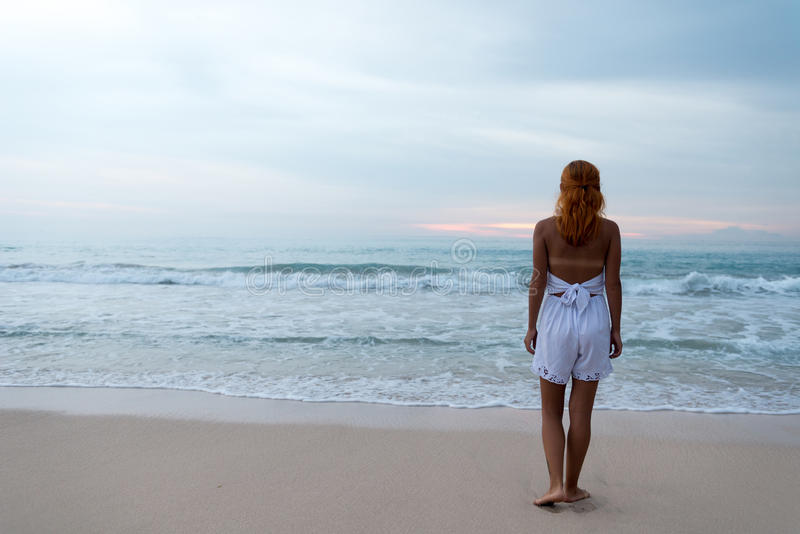 Download Young Woman Standing On Ocean Beach Stock Photo - Image of alone, coast: 38563618